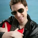Sexy rock man sunglasses leather jacket — Stock Photo #5499761
