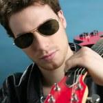 Sexy rock man sunglasses leather jacket — Stock Photo