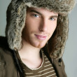 Winter fur hat portrait of fashion young man - Stock Photo