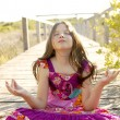 Royalty-Free Stock Photo: Hippy purple dress teen girl relaxed outdoors