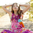 Stock Photo: Hippy purple dress teen girl relaxed outdoors