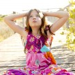 Hippy purple dress teen girl relaxed outdoors — Stock Photo