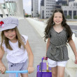 Little student girls going to school in city — Stock Photo