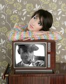 Retro woman in love with tv african hero — Stock Photo