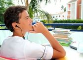Boy teenager relaxed outdoor earphones — Stock Photo