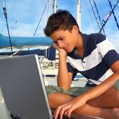 Boy teenager seat on boat marina laptop computer — Stock Photo
