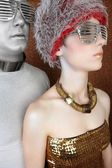 Alien futuristic fashion couple portrait silver gold — Stock Photo