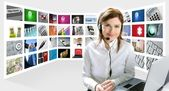Business redhead beautiful woman headphones tech helpdesk — Stock Photo