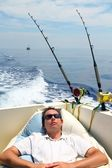 Sailor man fishing resting in boat summer vacation — Stock Photo