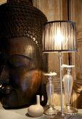 Asian face wooden sculpture — Stock Photo