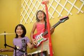 Live concert at home two little girls playing — Stock Photo