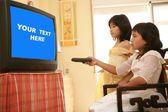 Asian girls as princess, tv remote control — Stock Photo
