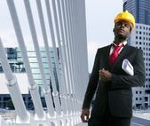 African american architect engineer yellow hardhat — Stock Photo
