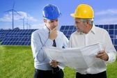 Two engineer architect plan hardhat solar plates — Stock Photo