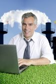 Senior businessman grass smog pollution — Stock Photo