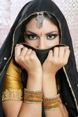 Beautiful brunette asian girl with black veil on face — Stock Photo