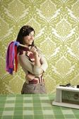 Retro housewife cleaning duster woman sixties — Stock Photo