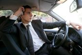 Young suit businessman inside his car — Stock Photo