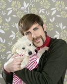 Geek retro man holding dog silly on wallpaper — Stock Photo