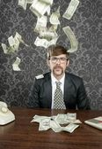 Nerd businessman retro office flying dollar note — Stock Photo