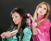Fashion hairdresser hair iron pink barbie 1980s — Stock Photo