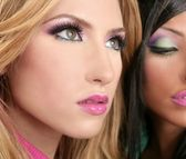 Barbie doll makeup macro blonde and brunette — Stock Photo