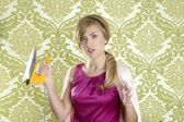 Hysterical retro woman vintage iron wallpaper — Stock Photo