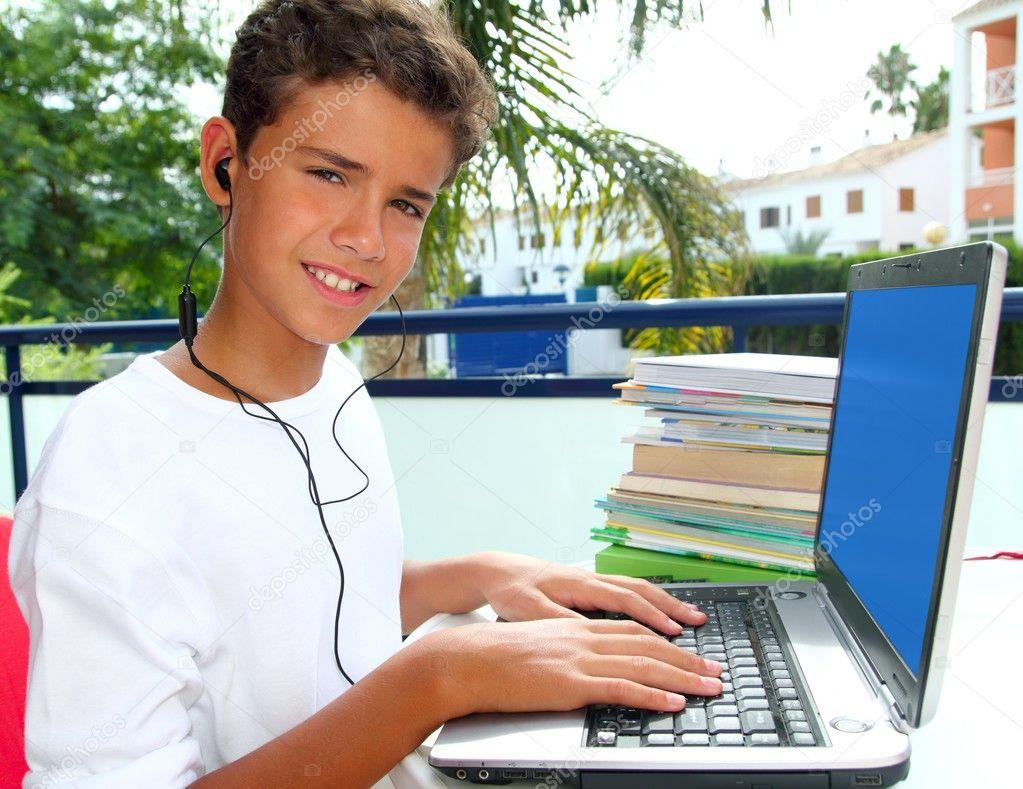 teenager student happy boy laptop earphones stock photo teenager student happy boy laptop earphones stock photo 5495039