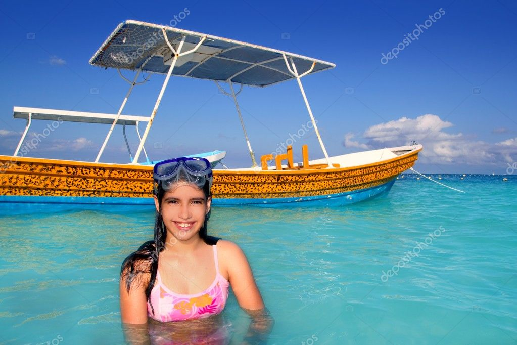 Latin teen girl in Caribbean beach with goggles