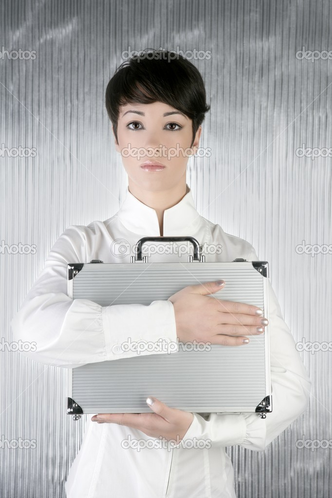 Androgynous businesswoman holding silver briefcase over gray background — Stock Photo #5495201