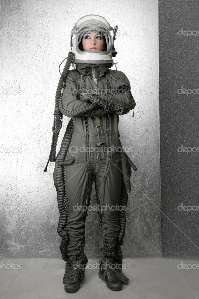 Astronaut fashion woman full length space suit helmet silver studio background — Photo #5495316
