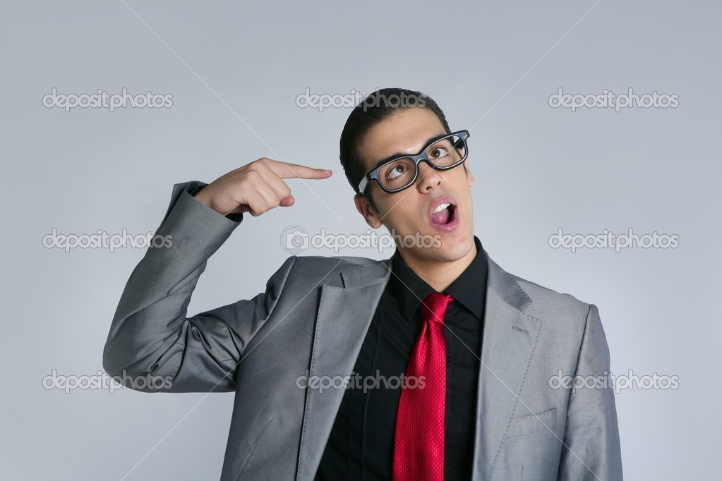 Businessman crazy with funny glasses and suit on gray background — Stock Photo #5496756