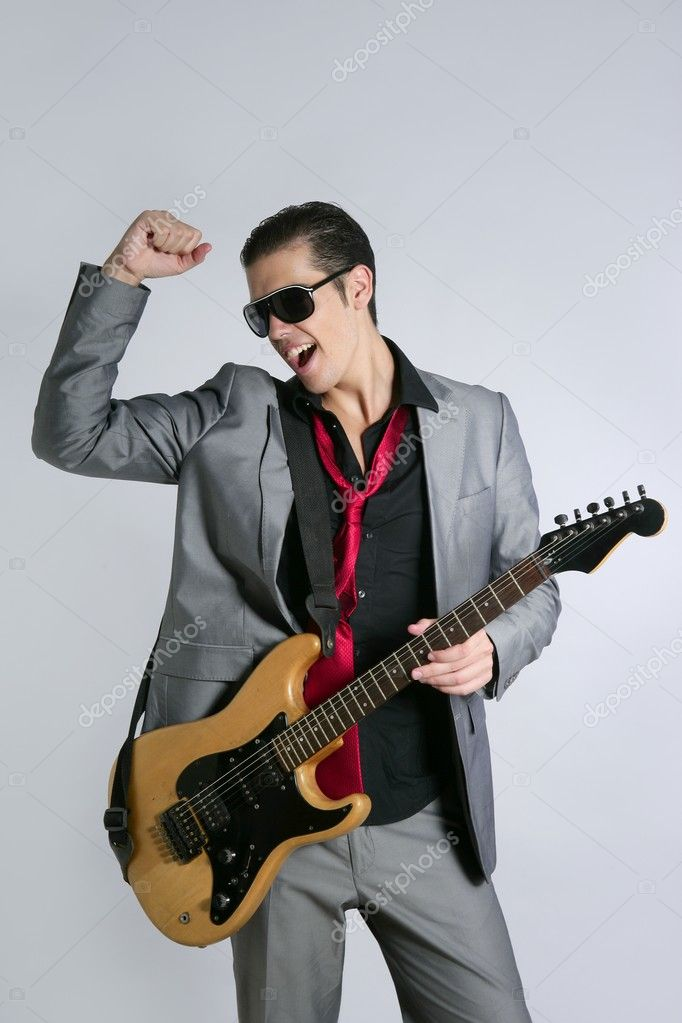 Businessman musician playing instrument with suit and tie  Stock Photo #5496795