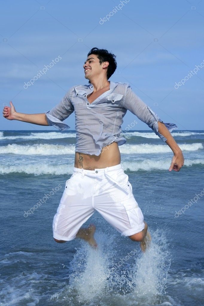 Handsome young man on the blue ocean beach summer sea — Stock Photo #5496906