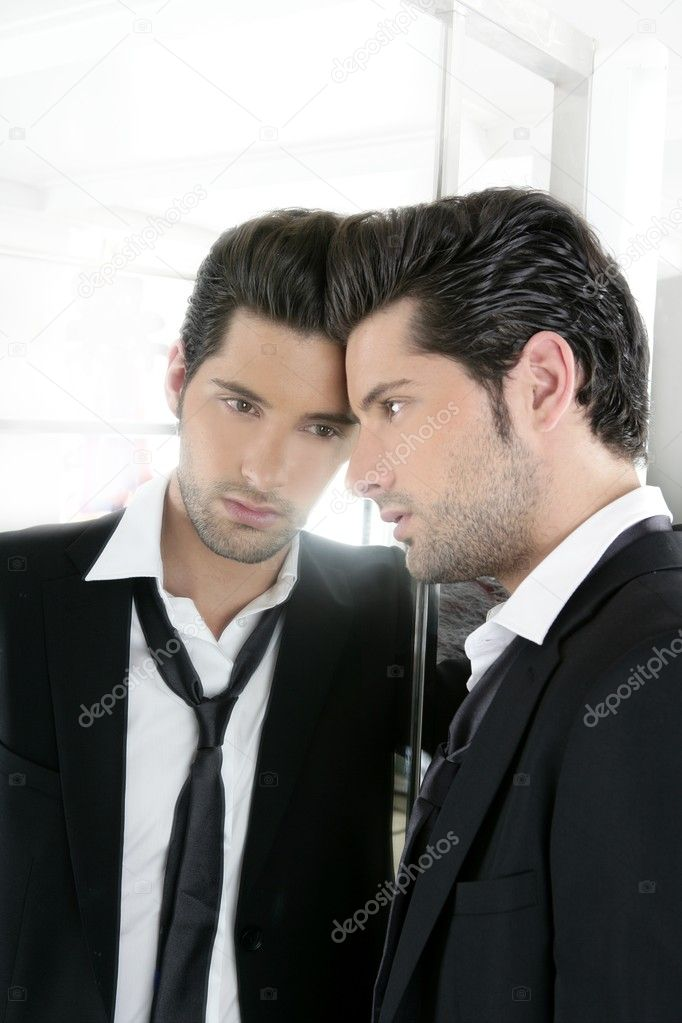 Handsome narcissistic suit proud young man looking himself in the mirror — Stock Photo #5497349