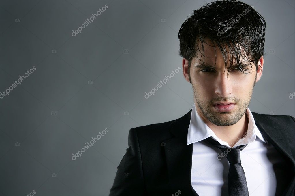 Fashion trendy suit young handsome man messy hairstyle dark portrait on gray — Stock Photo #5497518
