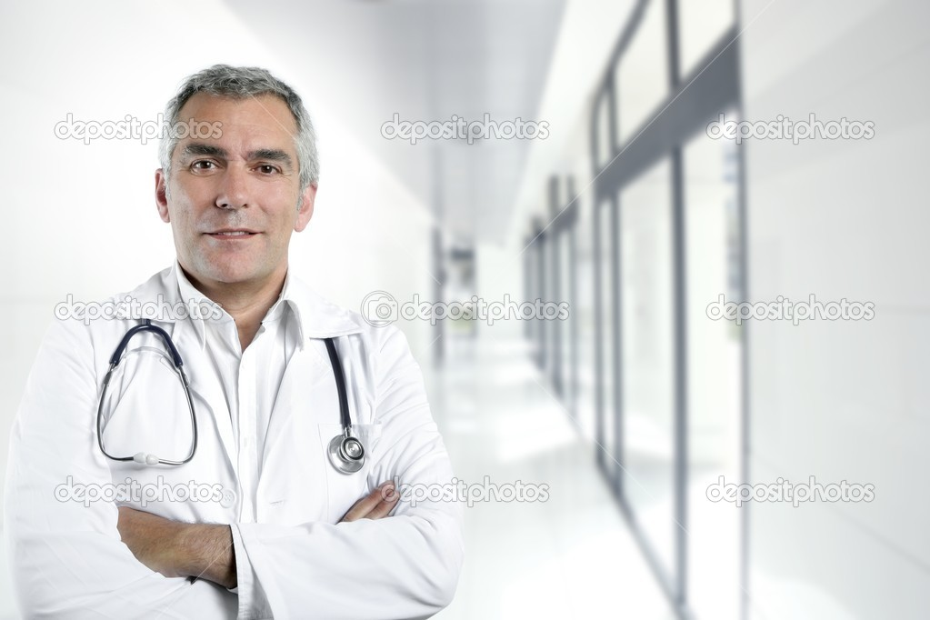 Gray hair expertise handsome senior doctor hospital portrait white corridor  Stock Photo #5497884