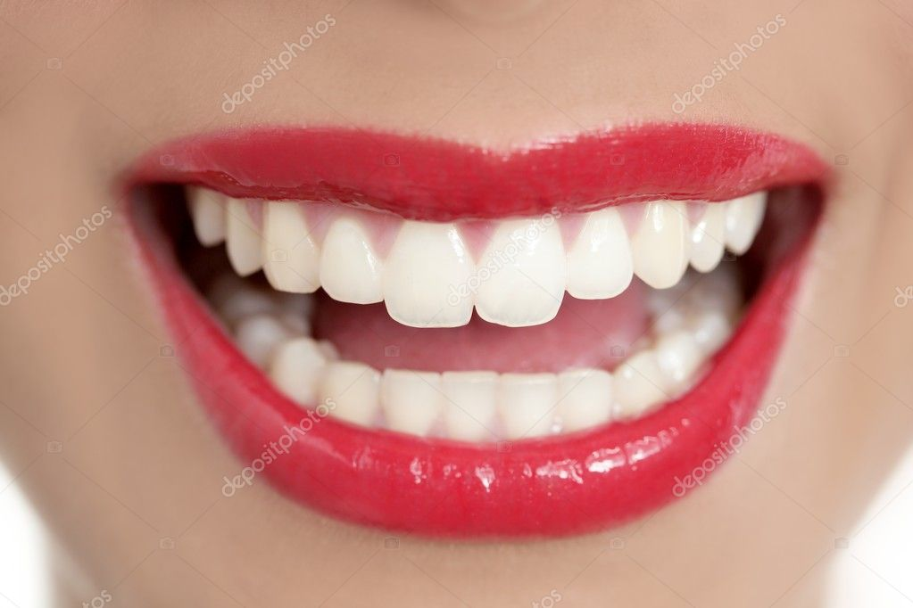 Beautiful woman perfect teeth smile with red lips  Stock Photo #5498555