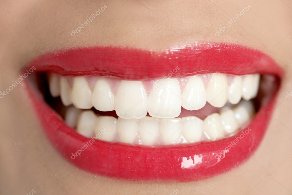 Beautiful woman perfect teeth smile with red lips  Stock Photo #5498557