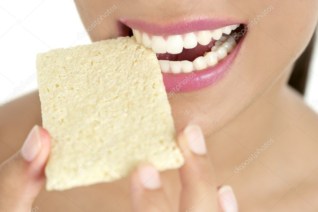 Biscuit in woman teeth and mouth having a healthy snack — Stock Photo #5498656