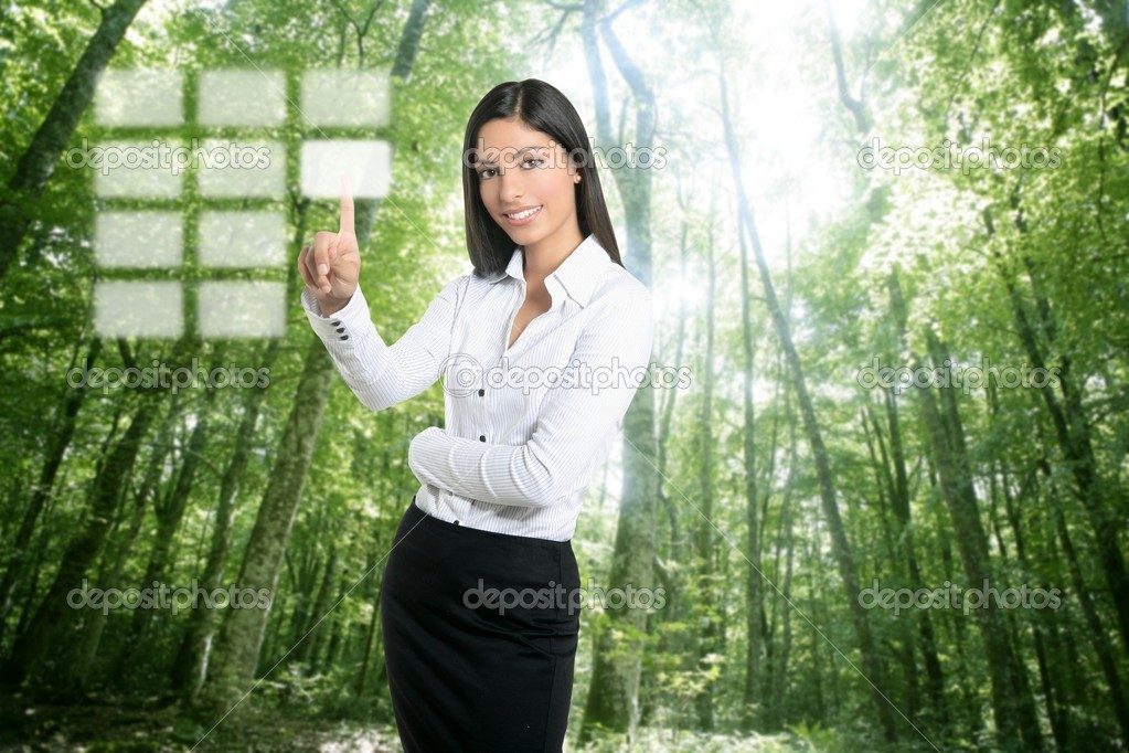 Brunette ecological businesswoman touching transparent key pad, ecology symbol  Stock Photo #5498700