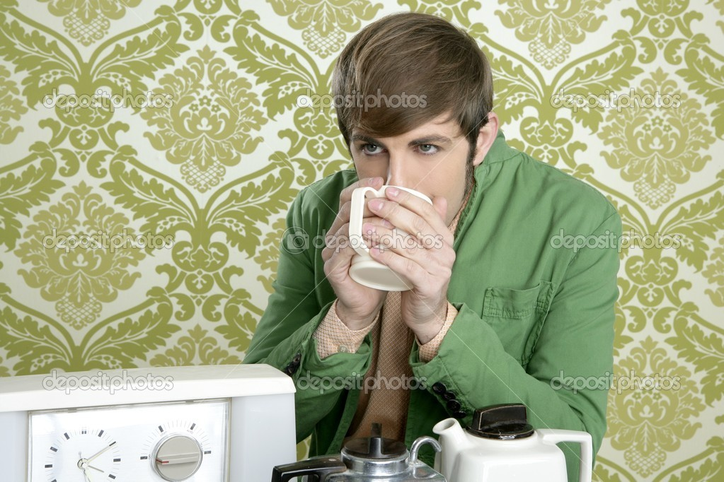 Geek retro man drinking tea coffee vintage teapot in wallpaper — Stock Photo #5499293