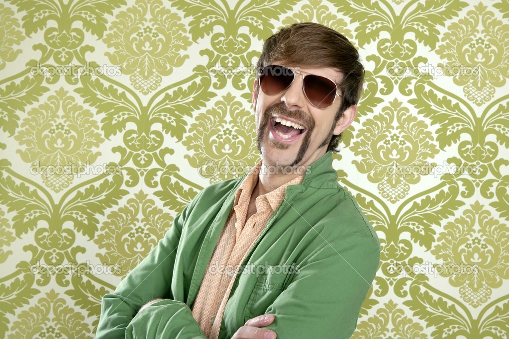 Geek retro salesperson man funny mustache sunglasses in green wallpaper — Stock Photo #5499298