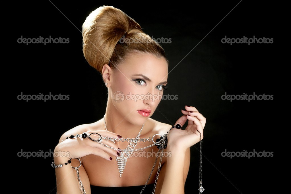 Ambition and greed in fashion woman with jewelry in hands on black background — Stock Photo #5499435