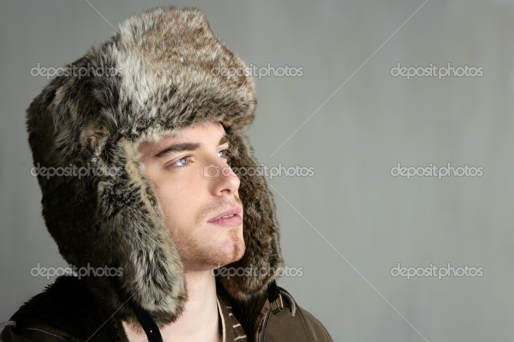 Winter fur hat portrait of fashion young handsome man — Stock Photo #5499828