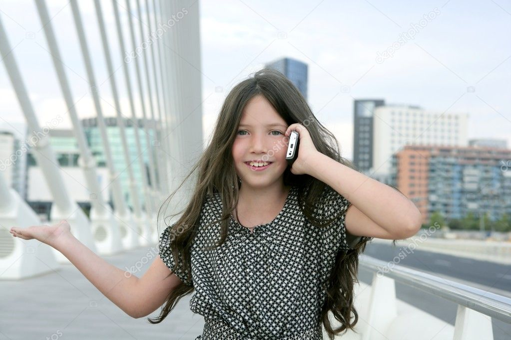 Adorable teenager little girl talking phone downtown in city bridge — Stock Photo #5499992