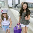 Stock Photo: Little student girls going to school in city