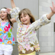 Two little girls dancing in the city — Stock Photo #5500048