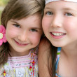 Closeup portrait of two little girl sisters - Stock Photo