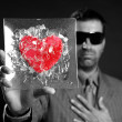 Broken red glass heart businessman metaphor — Stock Photo